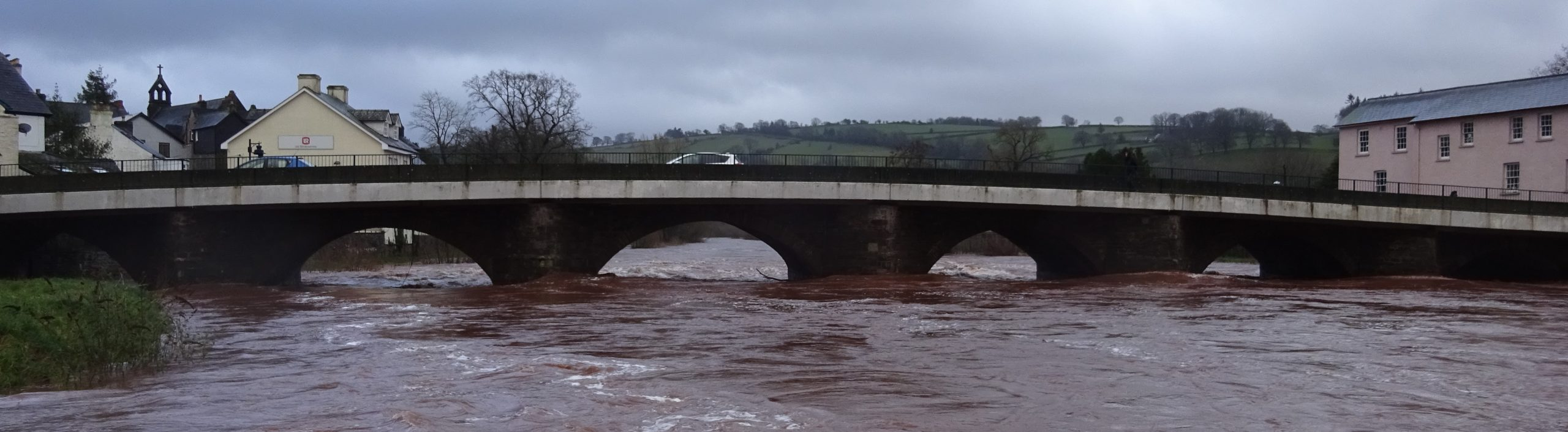 bridge spanning a flooded river